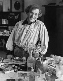 Photo of a smiling Marc Chagall in his studio in Paris, 1933.