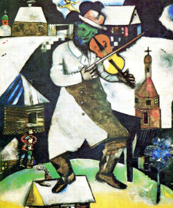 The Fiddler by Marc Chagall, green face with crooked nose, one foot on small roof, buildings behind with snow on roofs.