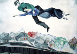 Over the Town, by Marc Chagall, Marc in green holds Bella in blue as they soar over a town of peaked roofs and fences yards with a tiny goat in one.
