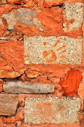 Closeup of a wall constructed with ochre mortar: Photo Copyright Marcia M. Mueller