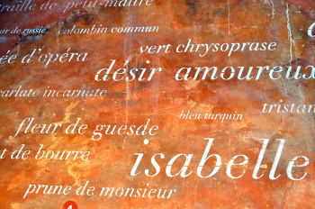 French names of ochre pigments made at the Matthieu Ochre Works in Roussillon handwritten on an ochre wall: Photo Copyright Marcia M. Mueller