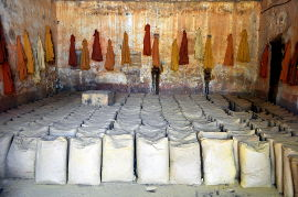 Jackets of ochre workers stained by ochre powders of many hues