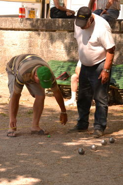 Men of Provence are precise and passionate boules players, as Vreeland shows in an animated scene: Photo Copyright Marcia M. Mueller