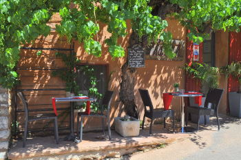 A sidewalk cafe in Roussillon: Photo Copyright Marcia M. Mueller